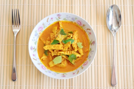 top view homemade pork and bamboo shoot curry with spoon and fork photo