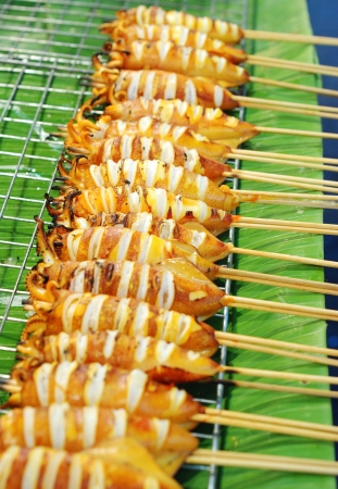 grill squid in row on banana leaf, Thai street food Stock Photo - 22551215