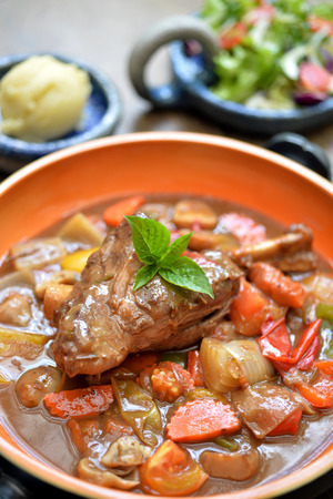 shank: Lamb shank in gravy with mix vegetable Stock Photo