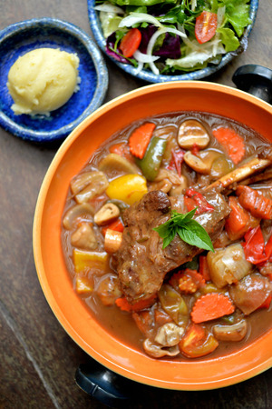 lamb shank: Lamb shank in gravy with mix vegetable Stock Photo