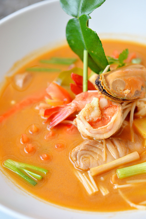 popular soup: Tom yum soup with shrimp, shell and fish. Popular Thai food Stock Photo