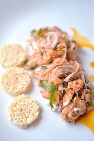 asian style: Spicy salmon salad with crispy rice, good salmon dinner Stock Photo