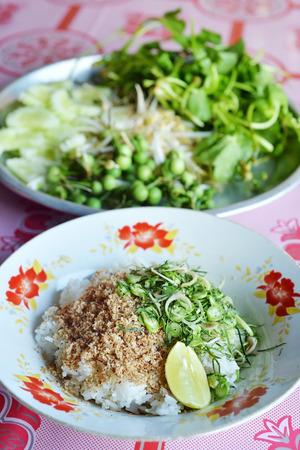 thai food: Thai rice salad with mix Thai herb, local Thai food Stock Photo