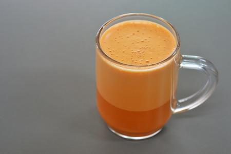 tarik: Milk tea on grey background Stock Photo