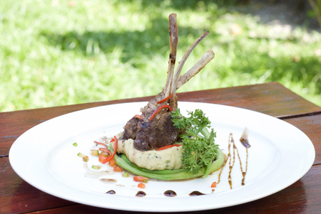 plates of food: Roasted Lamb Chops with sauce and mash potato