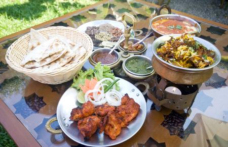 tandoori chicken: Selection of Indian food including tandoori chicken, nan, tikka and dipping