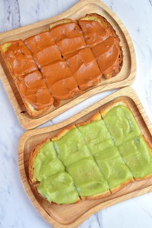 kaya: Toast with egg custard Kaya cream and milk tea custard on top Stock Photo
