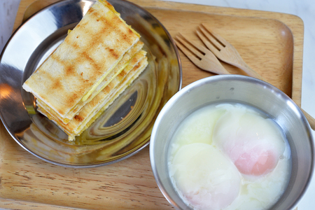 poach: Toast slice with poach egg, delicious breakfast Stock Photo