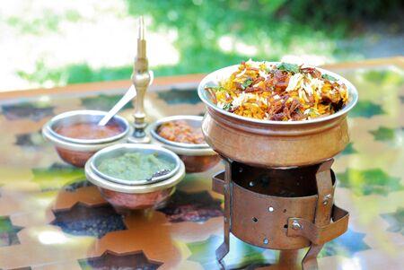 biryani: Indian Cuisine, close up of a bowl of indian golden biryani rice
