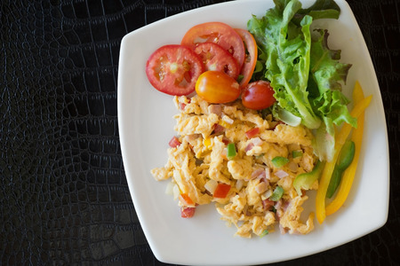 light breakfast: Selective focus of scramble egg with fresh tomato and vegetable