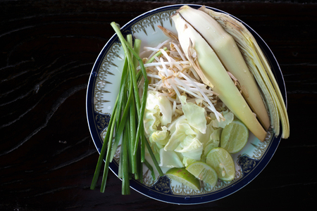 side dish: Fresh banana blossom with spring onion, bean sprout, lime and cabbage, side dish of Pad thai