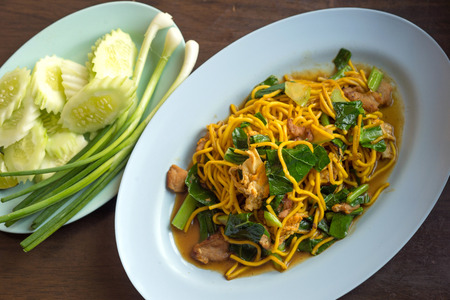 phuket food: Selective focus of Fry noodle with chicken and egg, Chinese Hokkien style Stock Photo