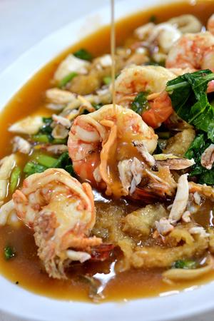 rad: Selective focus of shrimp soak in Rad na fry noodle in gravy