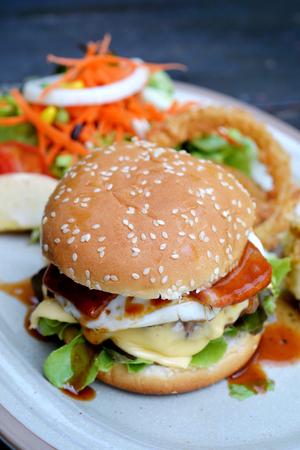 mash: Selective focus of hamburger with ham and cheese, mash potato, deep fry onion ring and salad