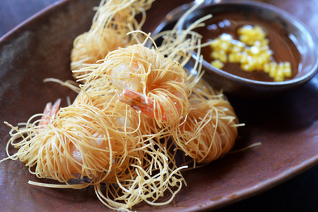 deep fry: Deep fry shrimp with rice noodle and sweet sauce, selective focus