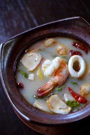 popular soup: Tom Yum Soup with shrimp and other seafood, selective focus popular Thai food