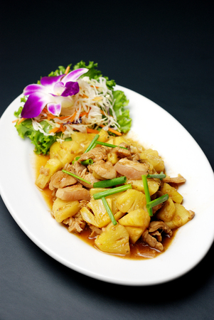 china cuisine: sweet and sour fry pork with pineapple, Chinese food, selective focus