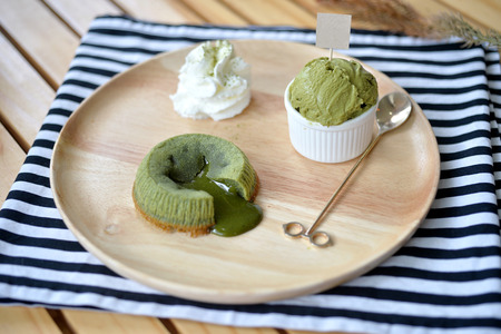 cream and green: Matcha Green Tea Lava Cake with ice cream, selective focus