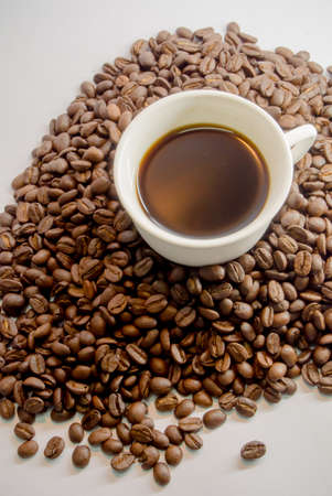 Cup of hot drink with coffee beans photo
