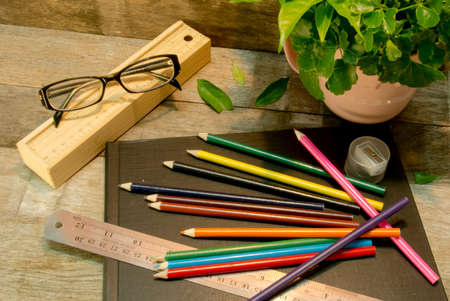 color pencils and Scale on black sketchbook Stock Photo - 21277679