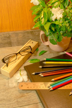 color pencils and Scale on black sketchbook Stock Photo - 21277686