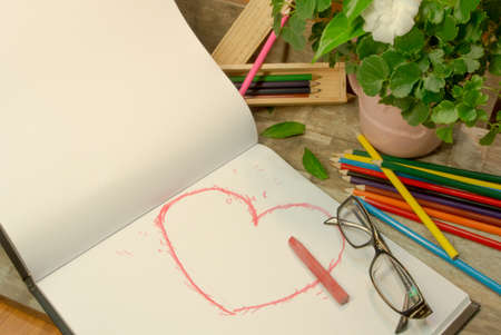 Hand draw style heart shape in red color on sketchbook Stock Photo