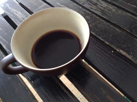 closeup: Coffee cup on wooden table Stock Photo