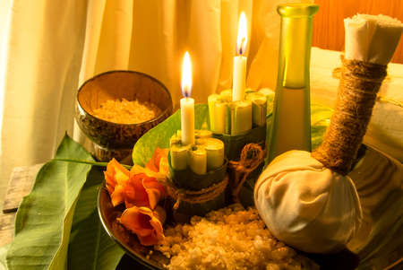 spa massage setting at sunset with candlelight