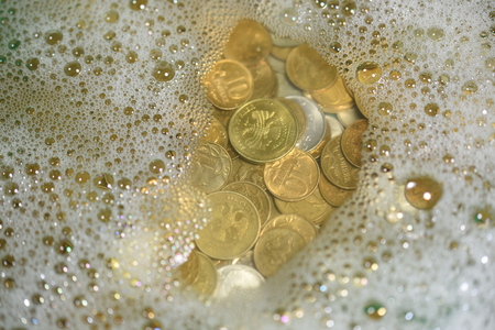 hoard: large pile of old, dirty coins soap water