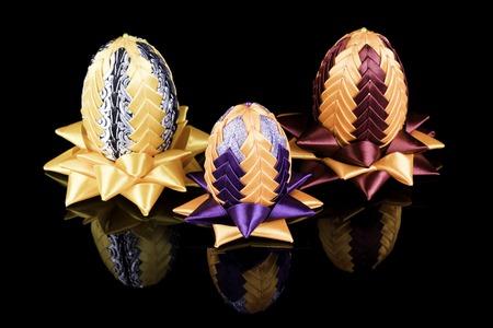 kanzashi: Hand made three Easter eggs kanzashi on black Stock Photo