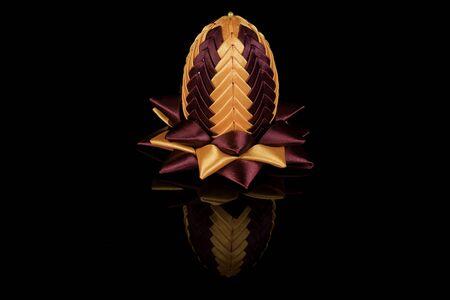 kanzashi: Hand made yellow-claret easter egg kanzashi on black