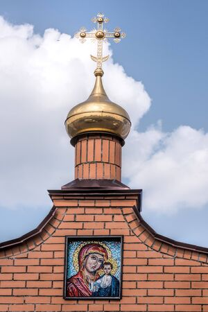 Golden domes and golden cross, sunny day