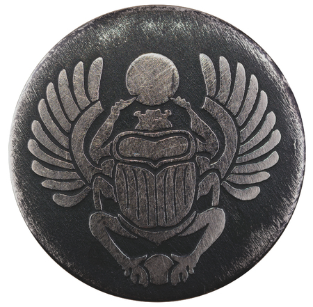 Scarabaeus carved in silver coin isolated on white background, an Anciant egyptian scarab beetle Stock Photo