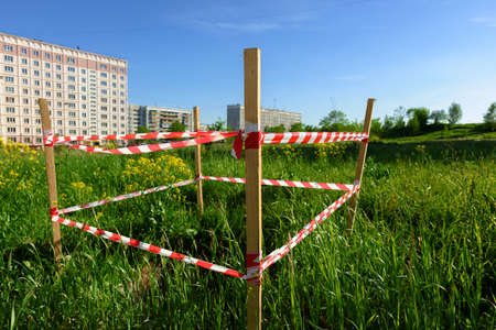 Warning tape attached to a wooden pole Stock Photo