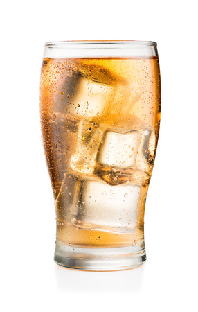 Glass of Guarana soft drink with ice cubes and condensation, isolated on white background with real shadow