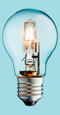 inteligent: Realistic photo image of a turned on halogen light bulb isolated on a cyan background and with a clipping path