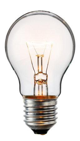 Glowing yellow light bulb, realistic photo image of a turned on tungsten light bulb isolated on a white background and with a clipping path Stock Photo