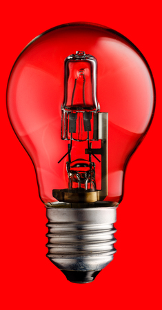 inteligent: Realistic photo image of a halogen light bulb isolated on a red background and with a clipping path