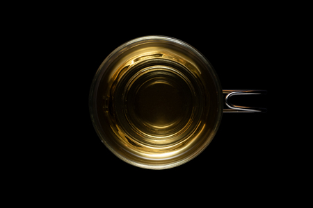 Top view of a glass cup of mint tea isolated on black background with clipping path
