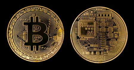 Crypto Currency Golden Bitcoin Isolated on Black Background. The Concept of Virtual International Currency and Business on the Internet With Clipping Path