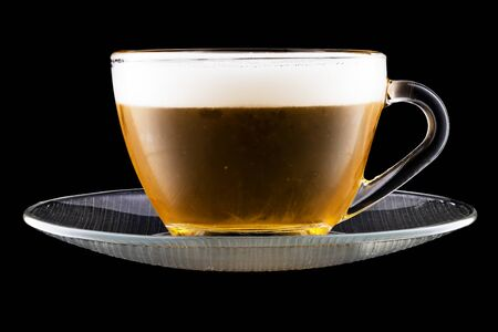 Saucer and Tea Cup With Beer Isolated On Black