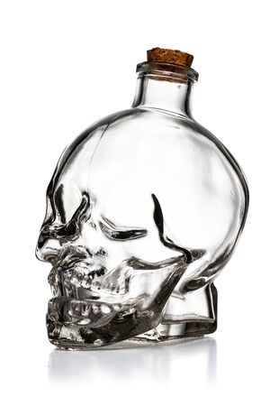 Empty Glass Skull Bottle Isolated on White Background With Clipping Path
