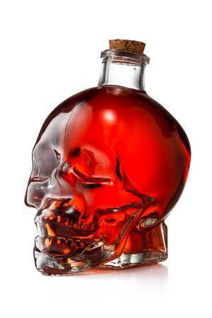Glass Skull Bottle Filled With Red Liquid Isolated on White Background With Clipping Path