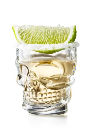 Skull Shaped Gold Tequila Glass Shot With Lime Slice and Salty Rim, Isolated on White Background With Clipping Path 版權商用圖片