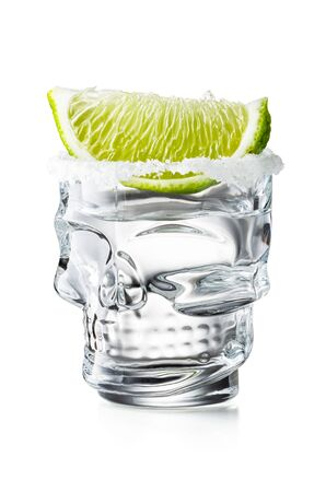 Skull Shaped Tequila Glass Shot With Lime Slice and Salty Rim, Isolated on White Background With Clipping Path