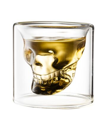 Skull Shaped Gold Tequila Glass Shot Isolated on White Background With Clipping Path