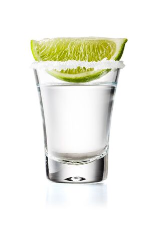 Tequila Glass Shot With Lime Slice and Salty Rim, Isolated on White Background With Clipping Path 版權商用圖片