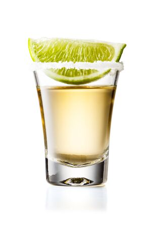 Gold Tequila Glass Shot With Lime Slice and Salty Rim, Isolated on White Background With Clipping Path