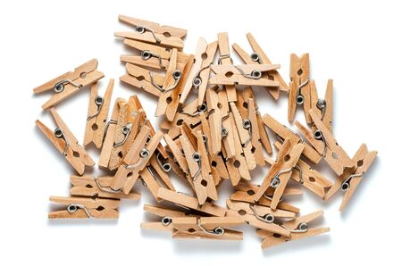 Top View of Pile of Wooden Clothespins Isolated on White Background