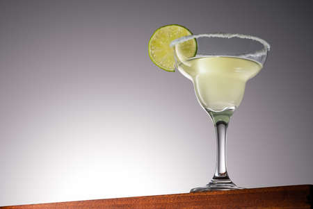 Margarita Cocktail on a Wooden Surface With Gradient Background